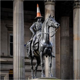 In the 1980's a traffic cone appeared on the head of the statue, attempts by the Glasgow City Council to remove the cone were unsuccessful as every time the cone was removed it mysteriously re-appeared.